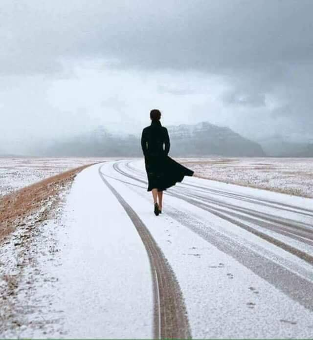 alone-woman-walking-snow